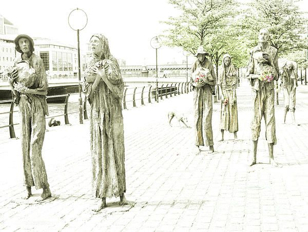 A Story Behind The Story. Famine Statues, Dublin, Ireland. Visit my photo gallery and get a beautiful Fine Art Print, Canvas Print, Metal or Acrylic Print OR Home Decor products. 30 days money back guarantee on every purchase so don't hesitate to add some Irish Magic in your home or office.