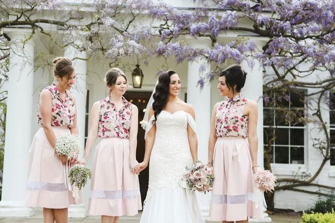 Bridesmaids wear floral blouses with pale pink skirts | Photography by http://www.funkyphotographers.co.uk/