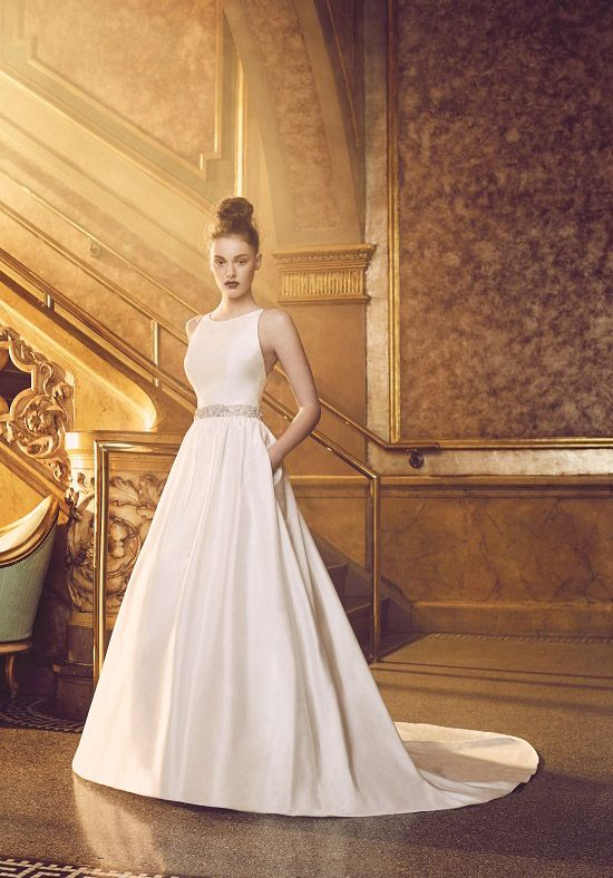 """Silk Dupioni Wedding Dress. Sleeveless bodice with bateau neckline and double beaded spaghetti straps. Full gathered skirt with hidden side pockets in skirt. Removable beaded Dupioni belt tied at waist.  Invisible zipper. """