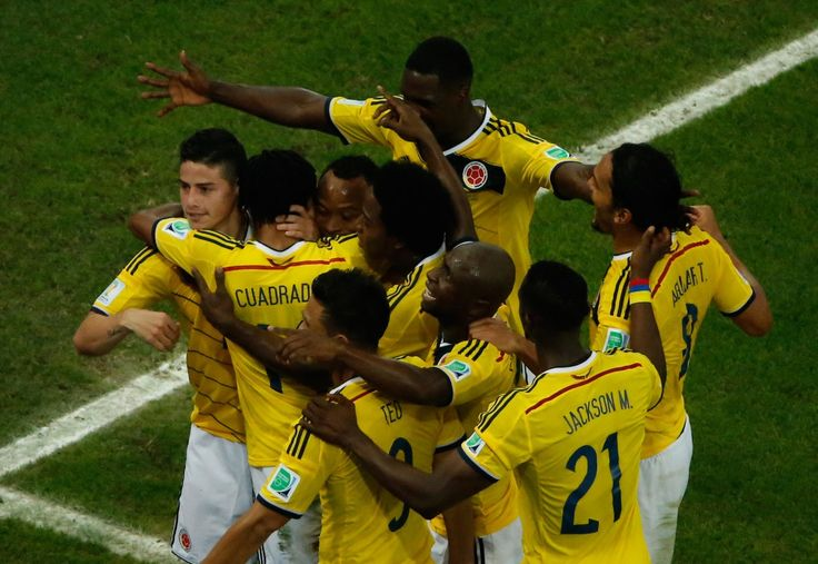 This World Cup Wonder Goal Needs To Be Seen Again And Again - Colombia's midfielder James Rodriguez (L/10#) dances with teammates as he celebrates his second goal during the Round of 16 football match between Colombia and Uruguay at The Maracana Stadium in Rio de Janeiro