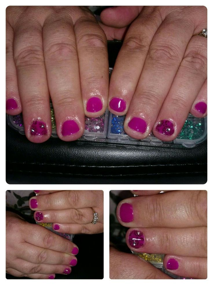 Dark pink gel colour on short nails with art design. https://m.facebook.com/Z.rune/