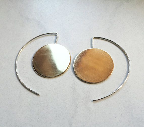 Large Brass Earrings, Geometric Round Silver Earrings, Dangle Long Earrings  These beautiful earrings are really lightweight and easy to wear. With their sleek design and large size will definitely draw some attention.  They are very strong and sturdy, but they are very comfortable. It is possible to put them also from the back of your ear! Made with two large brass discs and sterling silver ear hooks.  You will also receive a pair of silver posts to put behind them!  The metal I used in…