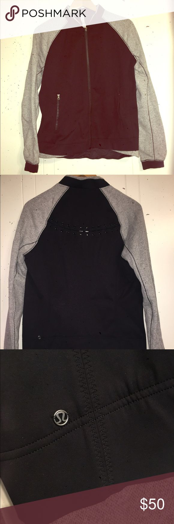 Lululemon black and gray zip up jacket! Black and grey tracksuit zip up jacket! Worn once! Beautiful crochet detailing on the back. Size 10. Black specs in photos are from broken phone- not actually on item!!! Make me an offer! 😃 lululemon athletica Tops Sweatshirts & Hoodies
