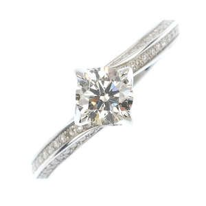 LOT:77 | An 18ct diamond single-stone crossover ring.