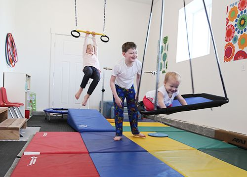 Garage gymnastics equipment. Living With Kids: Camille Turpin