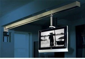 I'm a fan of this ceiling mounted tv on a sliding track that presumably swivels as well. Ideal for a craft studio or kitchen where you move around a lot.
