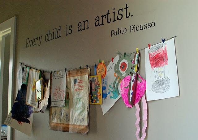 another approach to displaying kids art, and so simple to switch items in and out.