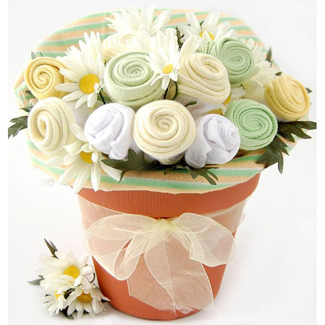 This Nikki's Baby Blossoms is a fun and unique way to say congratulations to the new parents. This gift bouquet features five adorable bibs, three ultra-soft washcloths, a cute one piece and a baby blanket rolled to look like a bouquet of fresh flowers.