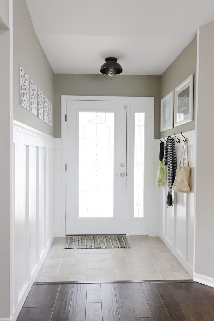 Tiny Entryway Idea: Not sure about the board and batten, but this is about the only idea I've seen that would work...