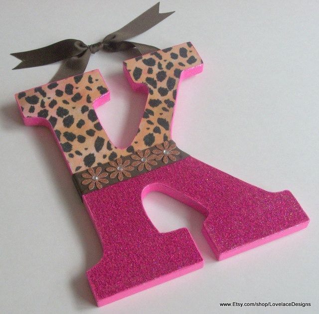Handpainted Wooden Hanging Wall Letters in Leopard Animal Prints by LovelaceDesigns Nursery Wall Letters Door Hangers UNIQUE and FUN. $20.50, via Etsy.