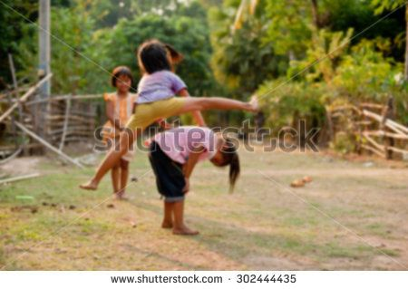 Unidentified Children of Laos play and fun of kids in countryside village on Champasak, Laos, blur background