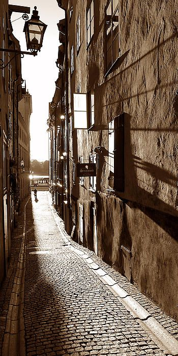 Stockholm's historic Gamla Stan, the old town, features an endless array of narrow streets, alleys and walkways between buildings. At times, it is hard to know which is which. It is especially picturesque early and late on sunny days when the long shadows add another element to an already charming setting. #cobblestone, #stockholm, #alley