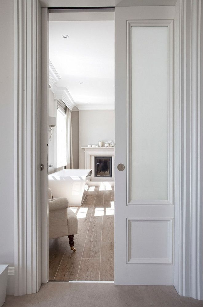 Bathroom door. A pocket door reveals a stunning bathroom complete with fireplace and free standing bath. #Bathroom #door #pocketdoor Hayburn & Co.