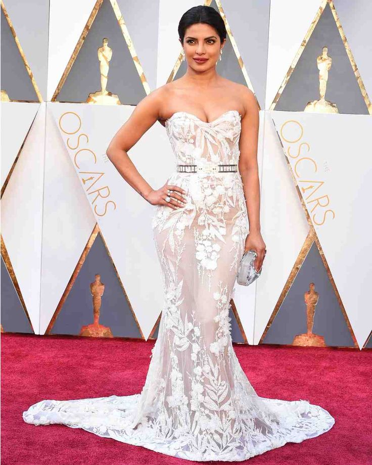 Red Carpet Dresses We'd Wear Down the Aisle | Martha Stewart Weddings - Calling all glam brides! Priyanka Chopra, a presenter at the 2016 Academy Awards, looked gorgeous in a curve-hugging strapless white Zuhair Murad gown complete with a sparkly belt.