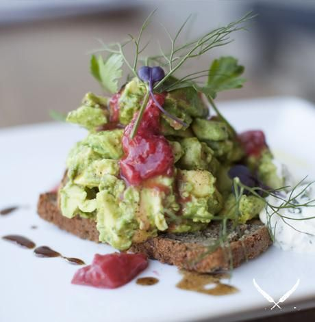 A favourite: Smashed avocado w/strawberry jalapeño chutney, herbed labneh, balsamic honey on nourished house loaf