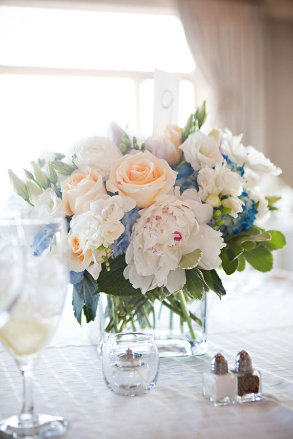 again, nice arrangement and height for tables, but bright orange and pink flowers to add to the white and blue