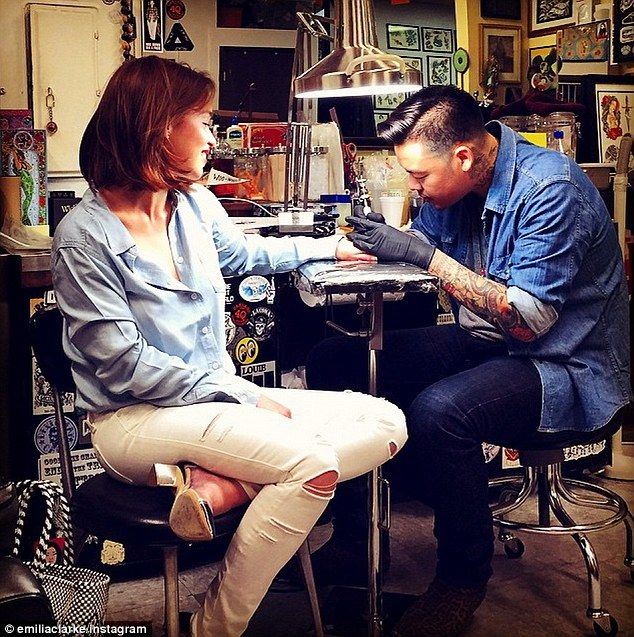 Khaleesi's first tattoo: Emilia Clarke shared a photo to Instagram on Friday while getting inked by Dr Woo