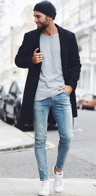 Try teaming a black overcoat with light blue skinny jeans to look classy but not particularly formal. A good pair of white low top sneakers are sure to leave the kind of impression you want to give.