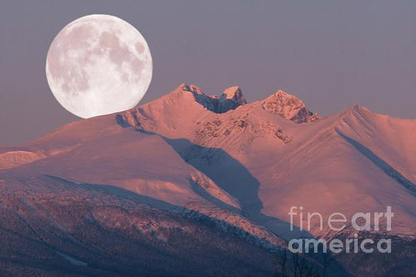 One freezing sunrise on midwinters day when the temperature was around -30 degrees, Ted took this photograph of the alpenglow lighting up Hudson Bay Mountain in Smithers in the Bulkley Valley in British Columbia, Canada. It was an unforgettable moment because the full moon from the previous night was setting over the mountain at the same time :-)