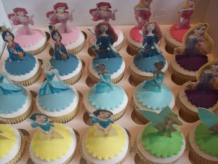 disney princess cupcakes - fondant dome covering buttercream, fondant skirt + rice paper image on a lolly stick pick