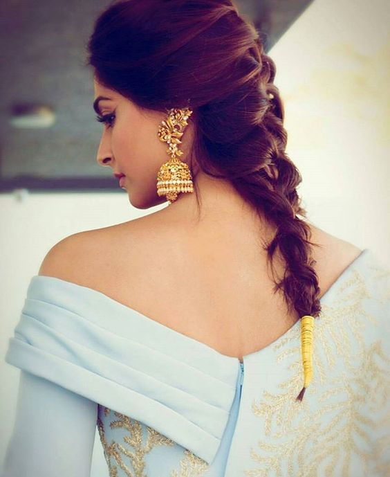 Sonam Rocks the simple french braid with that cute little gold end - Hair style ideas for the bride - The ultimate guide for the Indian Bride to plan her dream wedding. Witty Vows shares things no one tells brides, covers real weddings, ideas, inspirations, design trends and the right vendors, candid photographers etc.  #bridal #HairStyle #inspiration #IndianWedding   Curated by #WittyVows - Things no one tells Brides   www.wittyvows.com