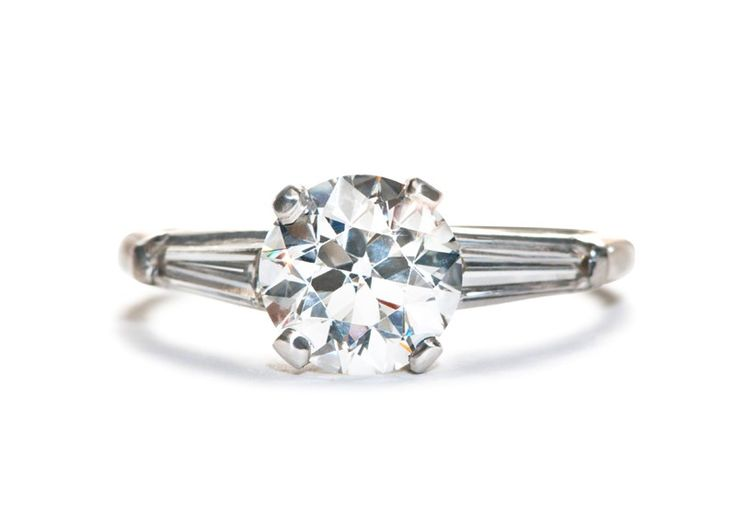 Clarkton is a tailored vintage 1950's diamond ring featuring a 1.44ct Round Briliant cut diamond flanked by two tapered baguette diamonds. Classic and sophisticated!   Trumpet & Horn   $16,500
