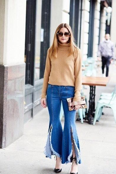 Olivia Palermo wearing Sjyp Steve J & Yoni P Frayed Flared Jeans and Fendi Sunglasses