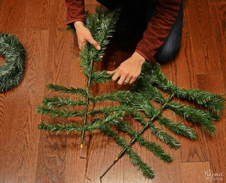 A husband and wife take apart a fake tree for this brilliant porch idea