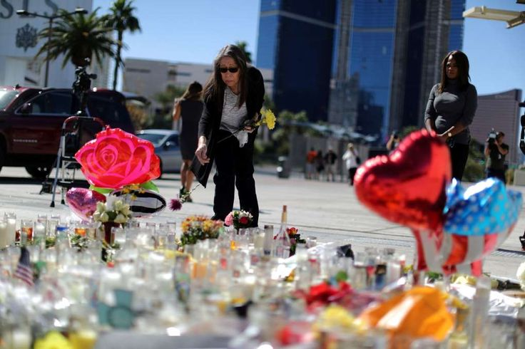 Trump says gun-control debate 'not for now' in wake of Las Vegas shooting  -  October 3, 2017:  A woman leaves flowers at a makeshift memorial on the Las Vegas Strip for victims of the Route 91 music festival mass shooting next to the Mandalay Bay Resort and Casino in Las Vegas, Nevada, U.S. October 3, 2017.