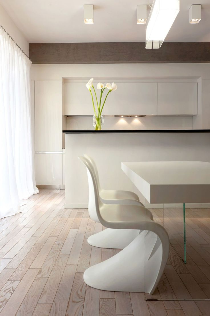 Pan Apartment by Carola Vannini Architecture. Panton chair #whitearmchair #diningroomchairs #chairdesign upholstered dining chairs, modern chairs ideas, upholstered chairs | See more at http://modernchairs.eu