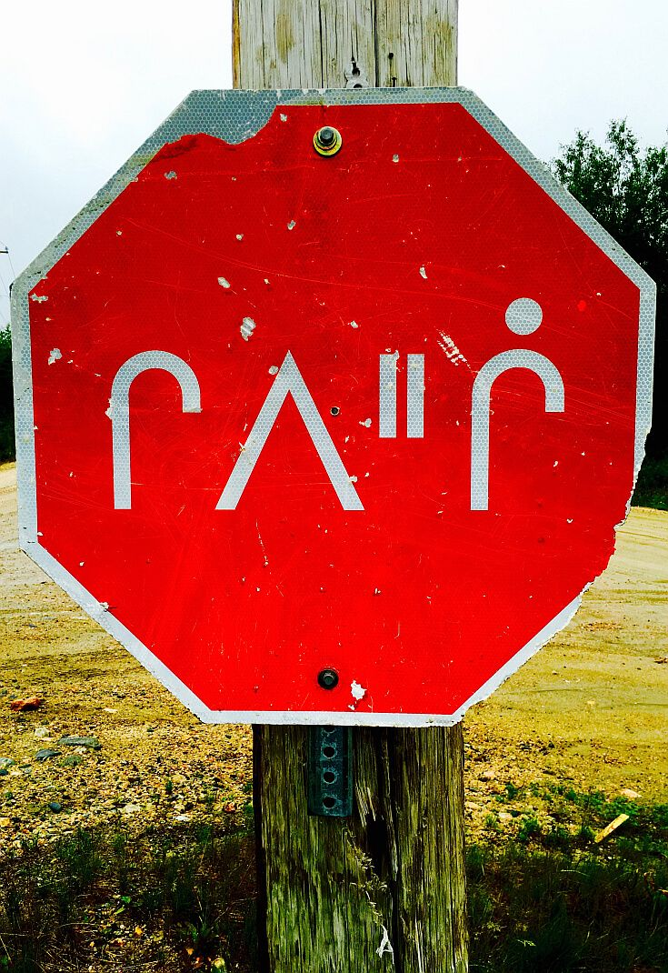 A stop sign in the Cree language in the wild outback of northern Quebec, Canada
