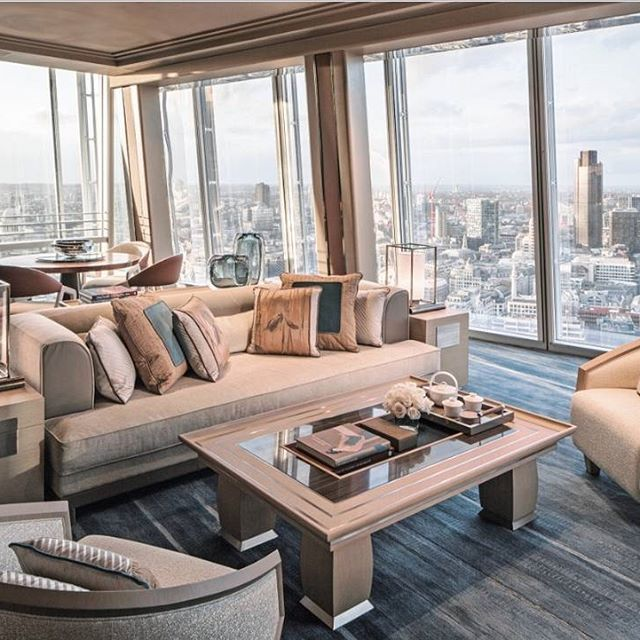 This spacious and light living room of the top of The Shard Skyscraper designed by Italian Interior design firm FM Architettura d'Interni