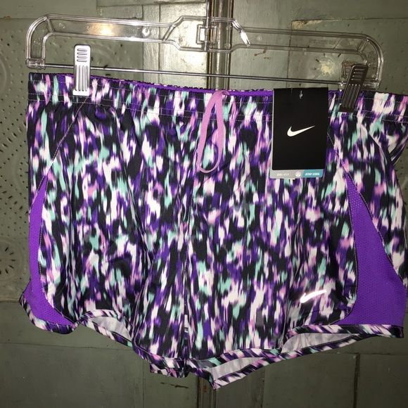 ⚽️NEW LISTING⚽️ NWT Nike shorts NWT Nike shorts that are purple, white, black and pink shorts Reg price$37 Nike Shorts