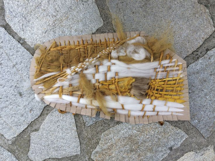 Weaving on cardboard - front. Learning to felt and weave in Piedmont, Italy.