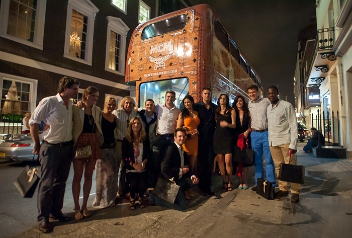 French national rugby player Serge Betsen, plus members of the Team GB Men's Hockey team outside the MCM bus.