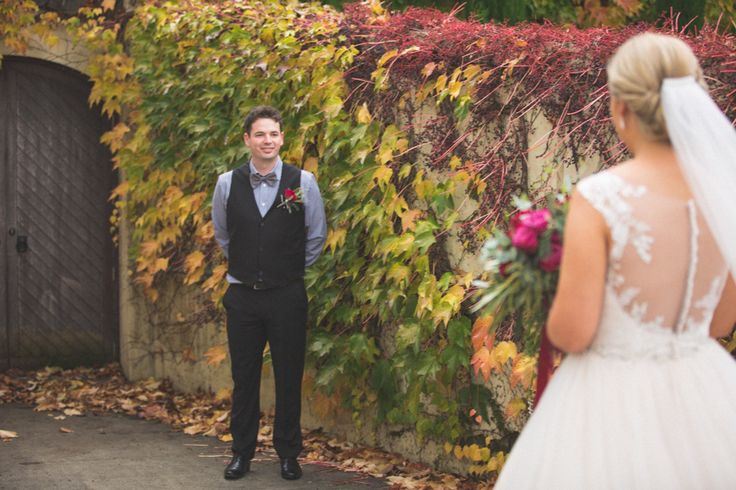 Romantic First Look. Bianca and James wedding day was a delicious tumble of rich red blooms and satin ribbon, blue gingham and bow ties, autumn colour and cute furry friends with thanks to Rei Bennett Photography.