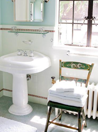 little white radiator in bathroom