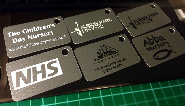 PVC key tags. Silver metallic finish. Black or white printing. Done by TEETO UK based plastic namebadges, key tags, plastic cards specialists