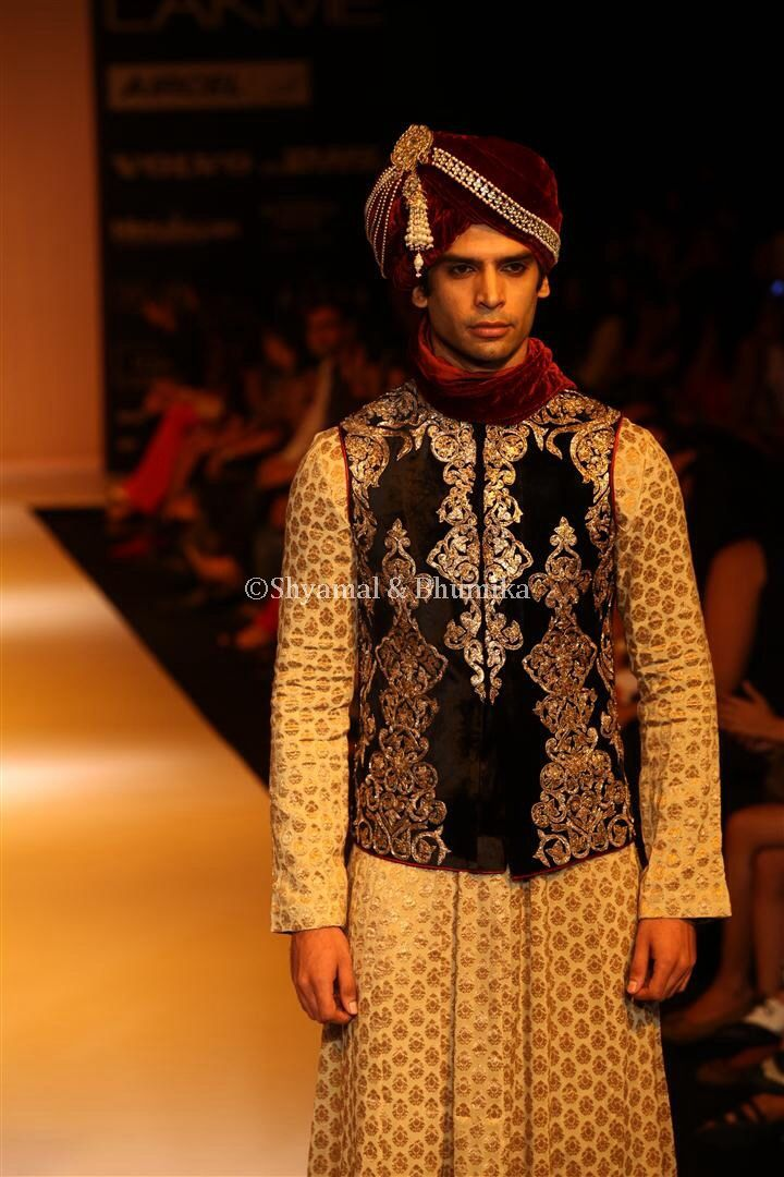 a jet black velvet bandi with ornate zari peeta embroidery all over, worn over an antique beige brocade kalidaar kurta, this outfit draws inspiration from the summer ensembles of the royal courts.