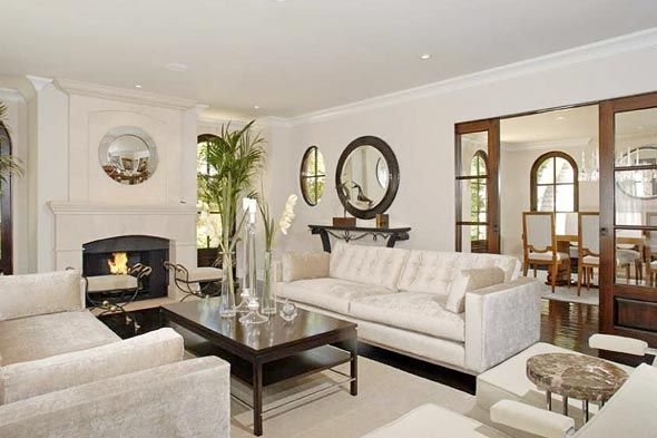 Kim K's Living Room-  This house is 4000 sq. ft. which includes five bedrooms, four and a half bathrooms and five fireplaces - including those in both the formal living room and formal dining room.