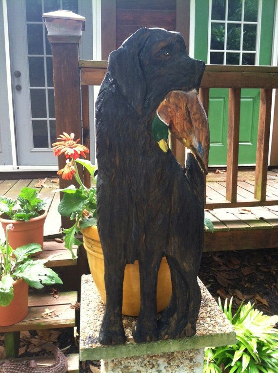 Black labrador retriever with mallard duck quot chainsaw
