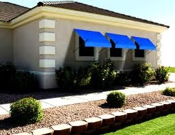 Solid Blue House awnings from Aleko awnings those provide a stunning look to your house.