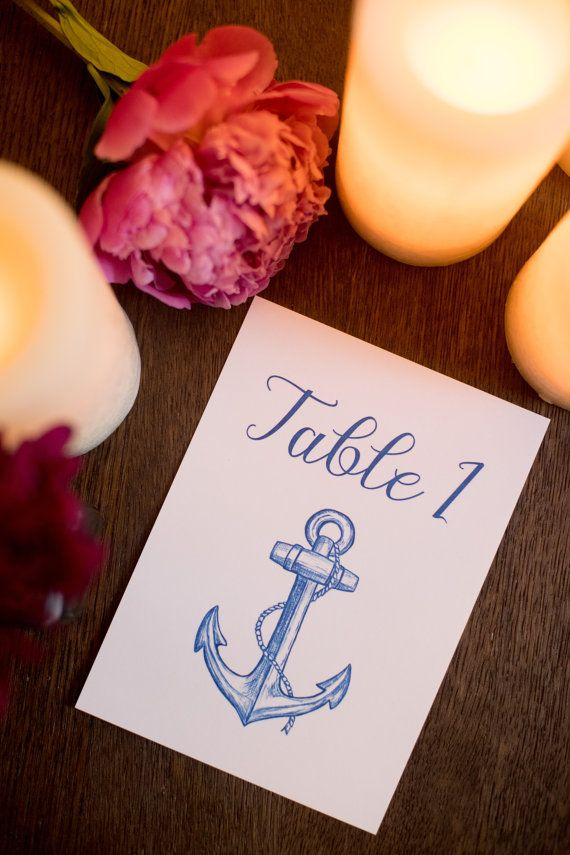 Love these unique hand drawn blue anchor wedding table numbers!  Pineapple street designs also has matching nautical wedding invitations, save the dates, escort cards, and menus!
