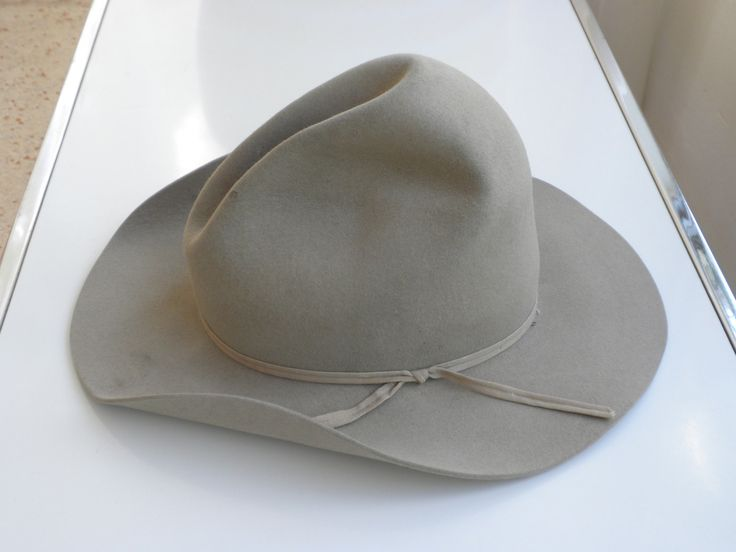 This is a genuine Western hat in the Tom Mix Style. Made by the Resistol Company of Garland, Texas, the largest manufacturer of western hats, and started in 1927. This hat dates to between 1938 and 1983. Somewhere in between is likely because of the addition of the plastic liner inside after WWII, and the 2 row ribbon band popular until the 50s. The union label inside from the UHCMW union used this label from 1934 to 1983. Resistol invented the Self conforming band in 1938.