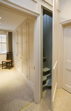 built-in cupboards and attic stairs in Georgian Cottage | Hackett Holland Ltd