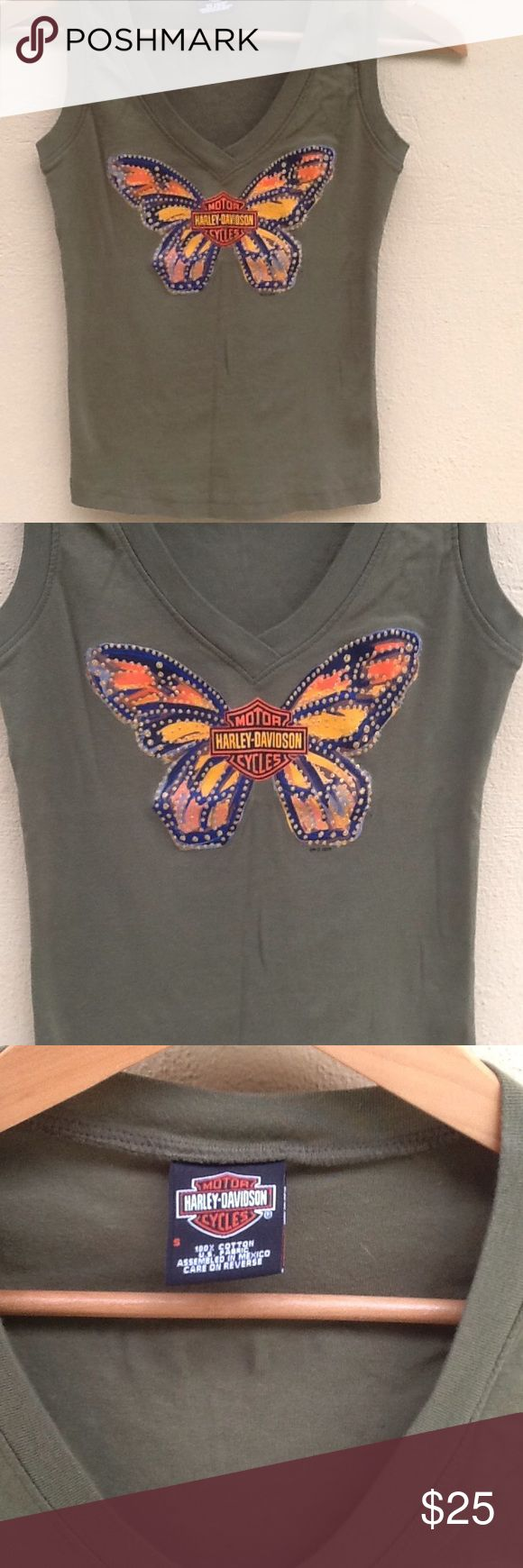 Harley-Davidson Ladies Tee Ladies tee by Harley-Davidson. This tee came from Honolulu ...chest measures 26... Length is 22. New cost was 49.00 Harley-Davidson Tops Tank Tops