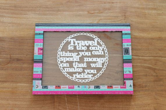 """Papercut art quote in an unique colorful frame; """"Travel is the only thing you can spend money on that will make you richer."""""""