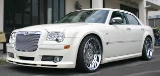 Chrysler 300M, a classy way to drive up. People that own these cars are attention getters, but the car is their best attribute