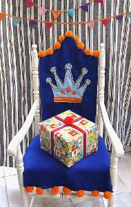 GONNA MAKE THIS FOR THE BOYS BIRTHDAYS!!  Let your child celebrate his birthday like royalty with a felt birthday chair slipcover! Use these chair slipcover patterns to learn how to make this festive decor.