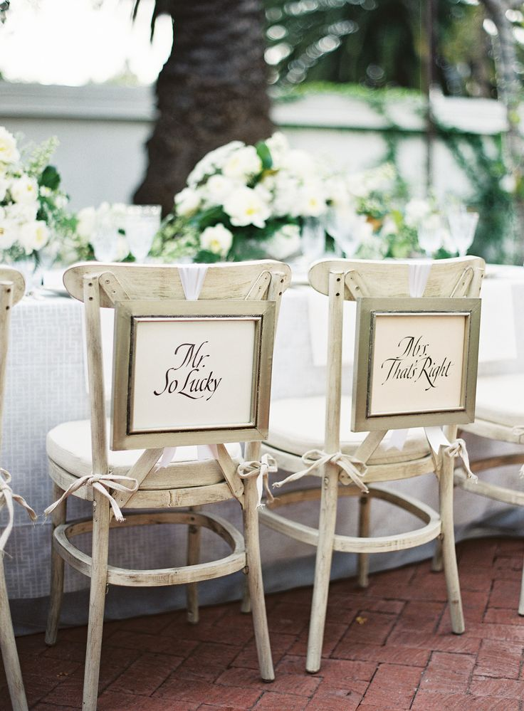 Chair Signs -- Mr. So Lucky and Mrs. That's Right! See more wedding inspiration from AlegriaByDesign.com  on #SMP here: http://www.StyleMePretty.com/2014/04/17/classic-elegance-inspiration-at-the-santa-barbara-club/  Photography: Patrick Moyer - patmoyerweddings.com
